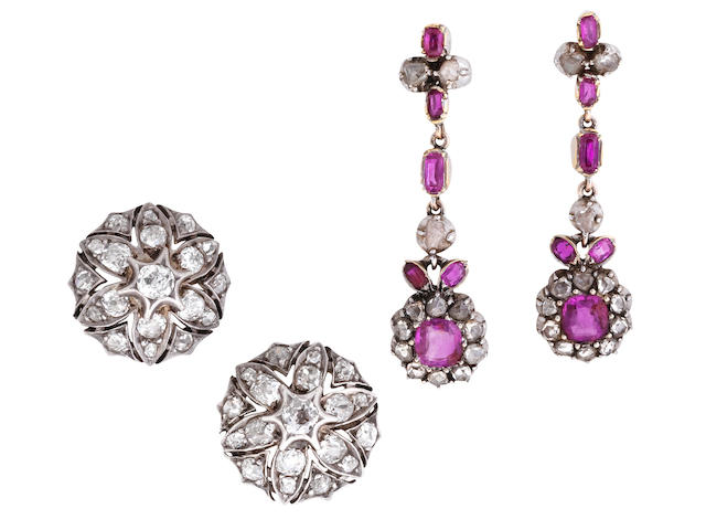 A pair of ruby and diamond pendent earrings and a pair of diamond cluster earrings