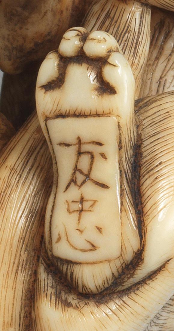 An ivory netsuke of a wolf  By Tomotada, Kyoto, Edo period (1615-1868), 18th century