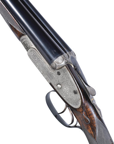 A fine 12-Bore Sidelock Ejector Gun By J. Woodward & Sons, no. 5305 In its leather case