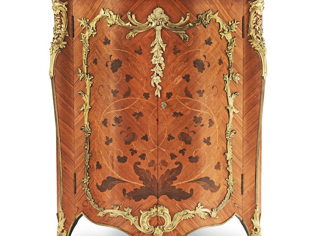 A French late 19th century gilt bronze mounted kingwood, bois satine and bois de bout marquetry encoignure by Gervais Durand in the Louis XV style