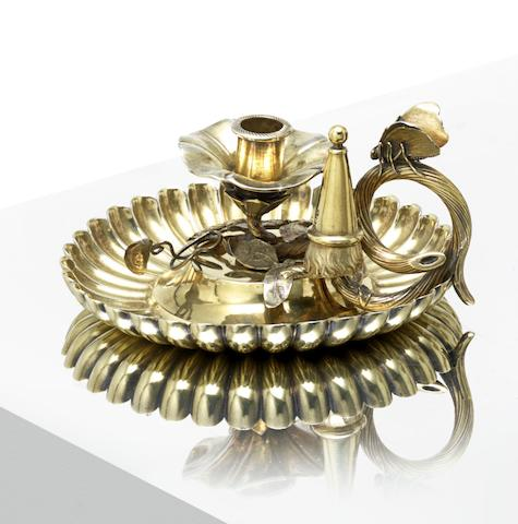 A George IV silver-gilt chamberstick by Phillip Rundell, London 1821