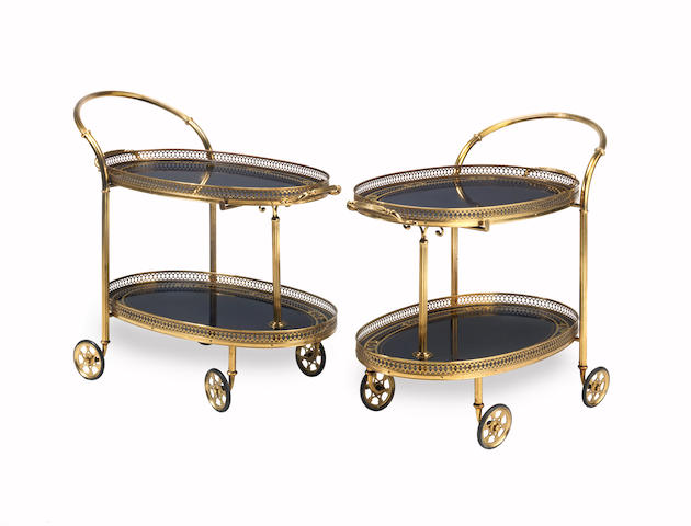 A pair of mid 20th century gilt brass and faux blue marble laminate decorated cocktail trolleys  Italian or French (2)