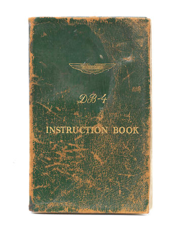 An Aston Martin DB4 Instruction Book, signed by Aston Martin drivers and personalities,   ((2))
