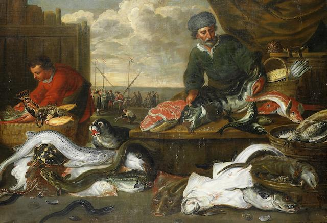 Studio of Frans Snyders (Antwerp 1579-1657) A fish stall with a view to fishermen unloading their catch on the beach beyond