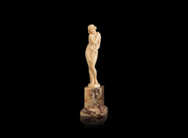 Joe Descomps  an Art Deco Carved Ivory Study of a Naked Female Clasping Floral Blooms, circa 1925