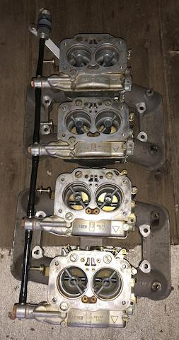 A set of  four linked Weber 42DCNF carburettors and inlet manifolds,
