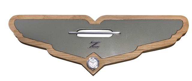 A unique 'Aston Martin Zagato' wall plaque, hand-crafted by members of the Aston Martin Works Service team at Newport Pagnell,  Offered for sale on behalf of Willen Hospice,