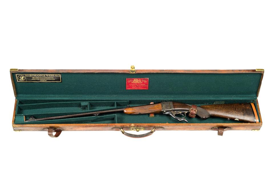 A .280 (Flanged) Farquharson falling-block rifle by George Gibbs, no. 20182 In a brass-mounted leather case with George Gibbs trade-label