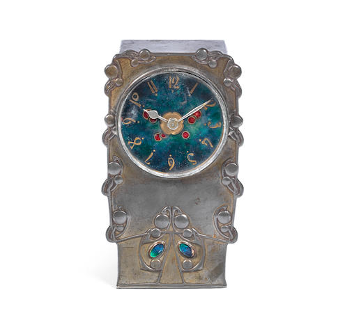 Archibald Knox For Liberty & Co An Arts and Crafts Pewter and Enamel Clock, circa 1905