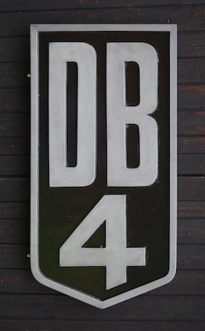 An Aston Martin 'DB4' garage display emblem,