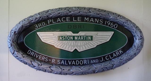 A hand-painted 'Aston Martin Le Mans 1960' commemorative oval plaque,