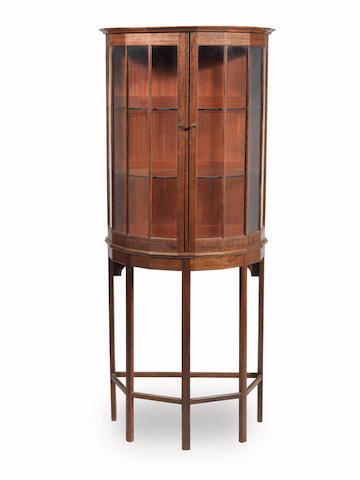A Hugh Birkett Arts and Crafts Style Bowfront Display Cabinet on Stand 20TH CENTURY