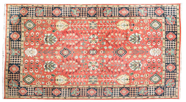 A large indian zegla style carpet 530cm x 368cm