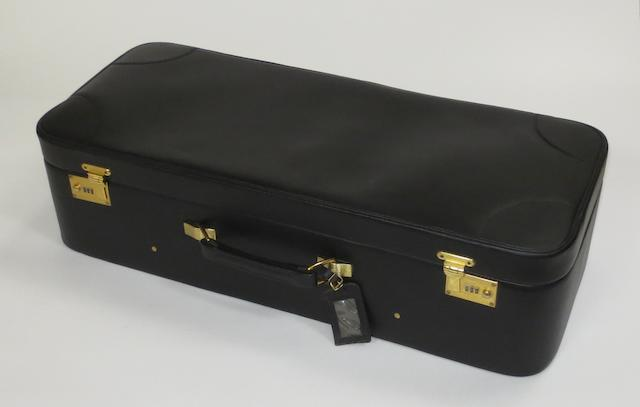 A leather suitcase by Tanner Krolle Ltd for Aston Martin V8 models,