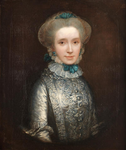 Thomas Gainsborough (Sudbury 1727-1788 London) Portrait of Lady Caroline Draper (circa 1730-1769), half-length, in a blue dress with a white lace cap held with blue ribbons, within a painted oval in a hollow-carved frame
