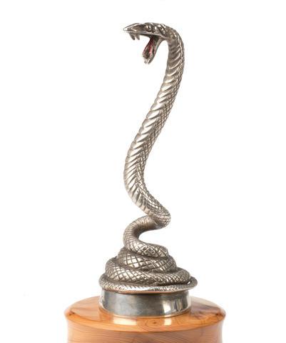 A 'Coiled Serpent' mascot by Desmo, British, circa 1930,