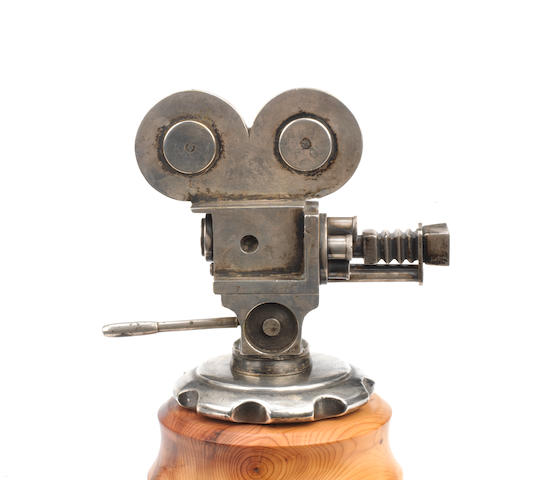 A rare 'Movie Camera' mascot, British, Registered Design 1930,