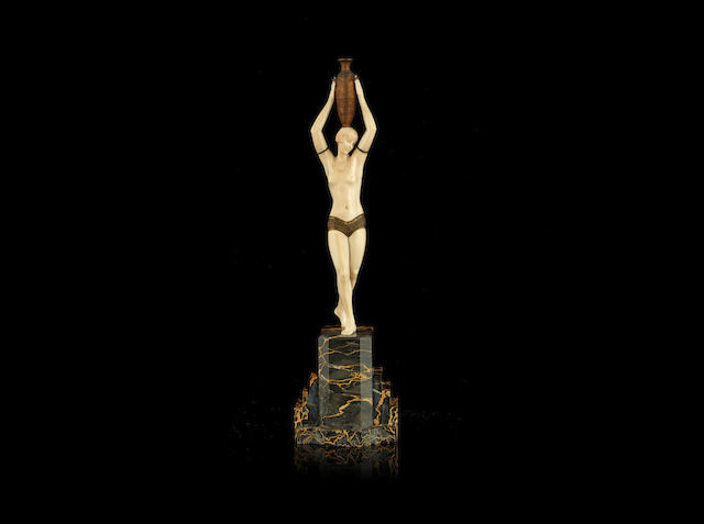 Pierre le Faguays an Impressive Art Deco Gilded Bronze and Carved Ivory Study of a Bare-Breasted Female with Amphora, circa 1925