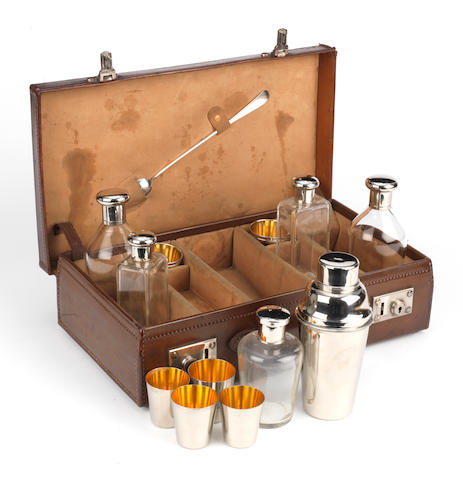 A leather cased cocktail set for four persons, circa 1909,
