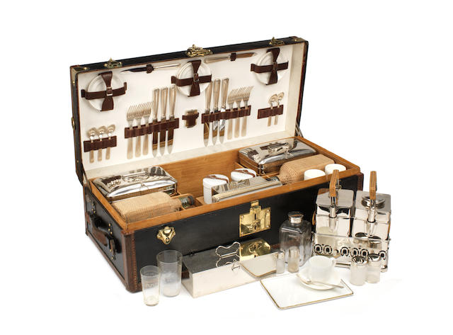 A fine and impressive cased picnic set for six persons by Moynat of Paris, circa 1907,