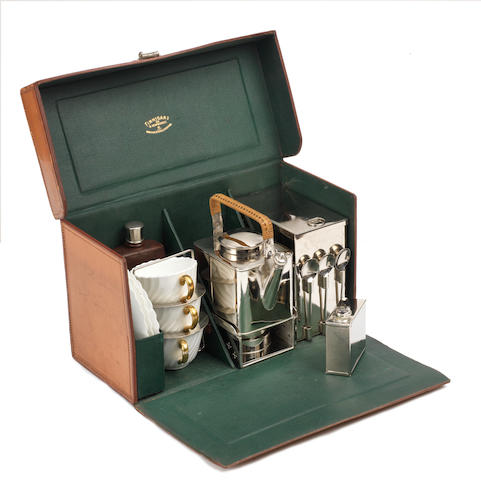 A leather-cased tea-set for three persons by Finnigans of New Bond St, circa 1905,