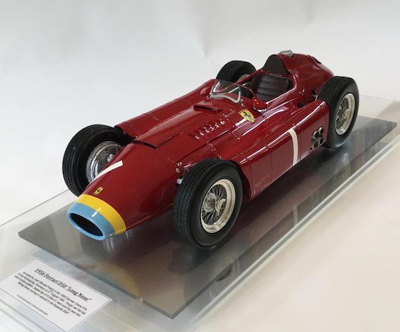 A fine 1:8 scale scratchbuilt model of the 1956 German Grand Prix winning Scuderia Ferrari Lancia D50 by Javan Smith,