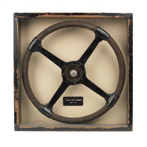 A Three Litre Sunbeam steering wheel, in framed display dated 1925-26,  ((3))