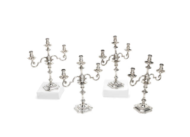 A set of four three-light silver candelabra from the Painted Hall at Greenwich by Goldsmiths & Silversmiths Co Ltd, London 1938  (4)