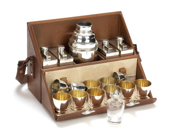 A FINE LEATHER-CASED TRAVELLER'S COCKTAIL BAR SET FOR EIGHT PERSONS BY P.H.VOGEL & CO., BRITISH,