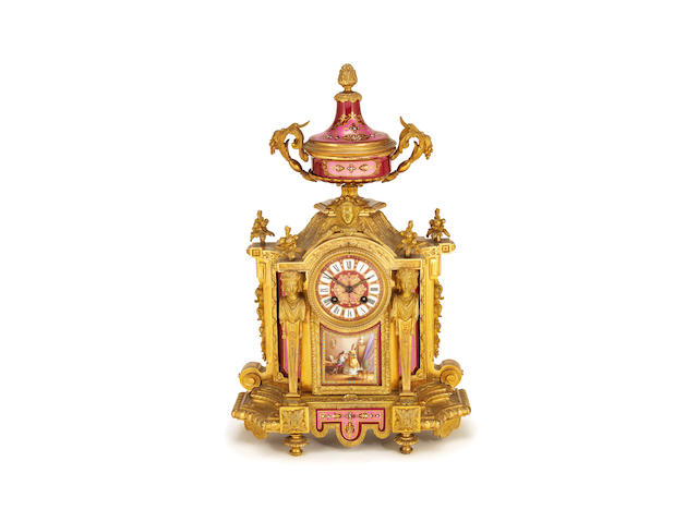 A late 19th century French gilt bronze mounted Sevres style pink and claret porcelain mantel clock in the Louis XVI style,