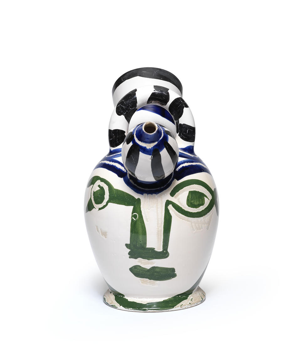 Pablo Picasso (Spanish, 1881-1973) Pichet à glace  stamped, marked and numbered Edition Picasso/Madoura Plein Feu/Edition Picasso/17/50/Madoura (underneath)white earthenware ceramic vessel, partially engraved, with colored engobe and glazeHeight: 34 cm.Conceived in 1952 and executed in a numbered edition of 50