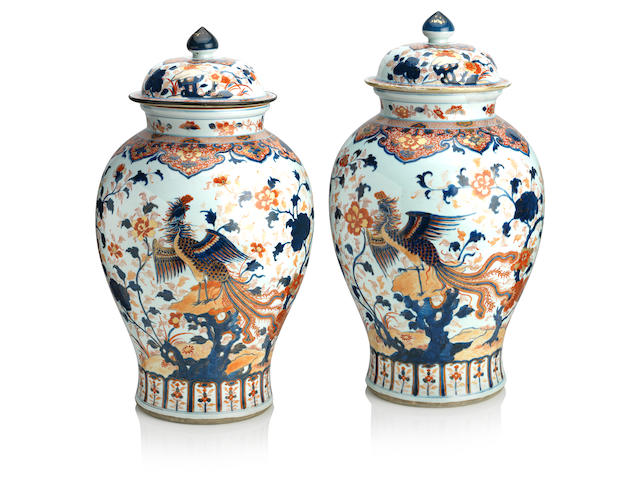 A pair of large Imari pattern temple jars with covers 18th century (4)