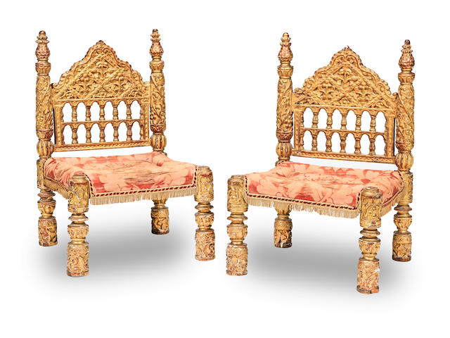 An interesting pair of carved giltwood low chairs, Indo-Portugese 17th century or possibly 16th century