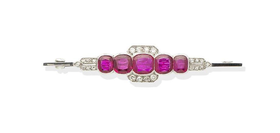 A ruby and diamond bar brooch,