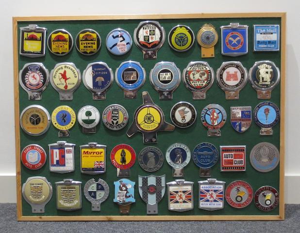 A framed display of Motoring Press Club car badges,