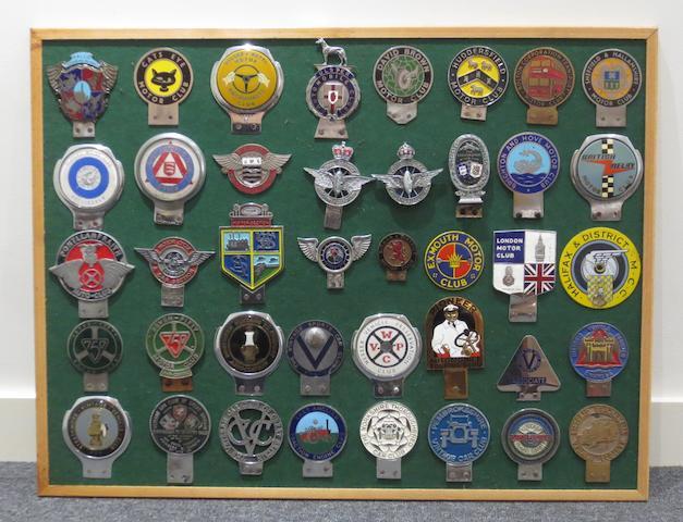 Bonhams : A framed display of British Motor Club car badges,