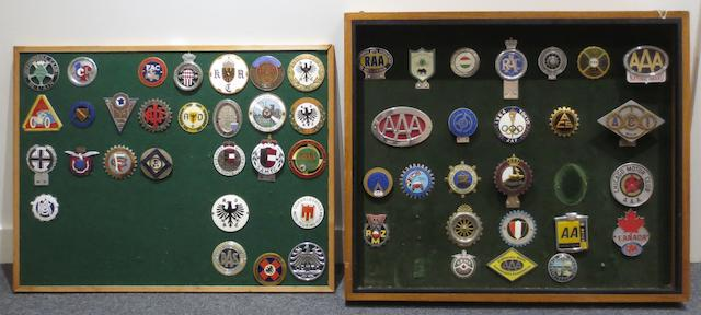 Two framed displays of European and other foreign motoring club car badges,   ((3))