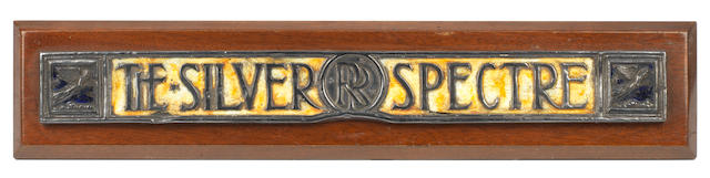 "A Rolls-Royce 40-50Hp enamel name badge ""The Silver Spectre',"