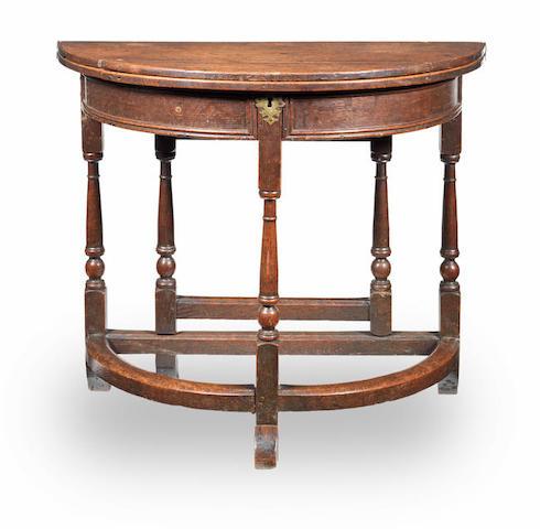 A small joined oak half-round box-top folding table, English, circa 1710-30