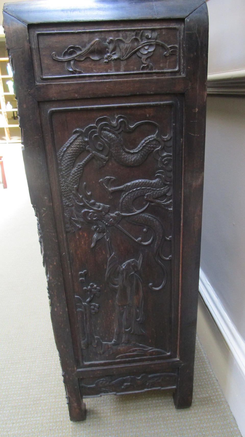 A carved hardwood side cabinet Late 19th century
