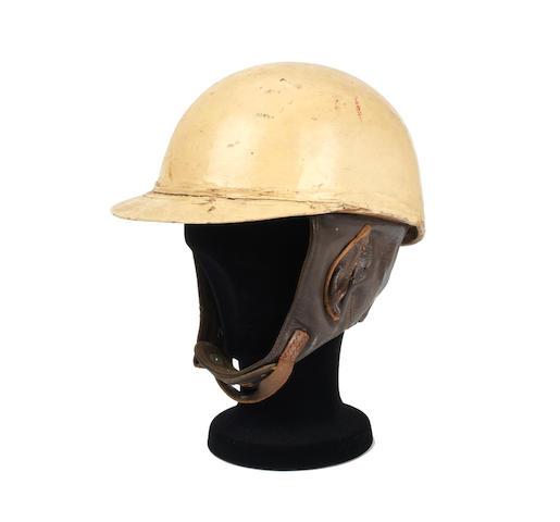 A 1950s peaked race helmet,