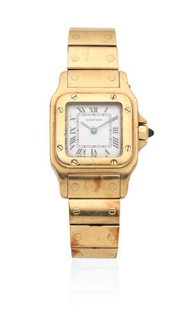Cartier. A lady's 18K gold quartz rectangular bracelet watch  Santos, Circa 2000