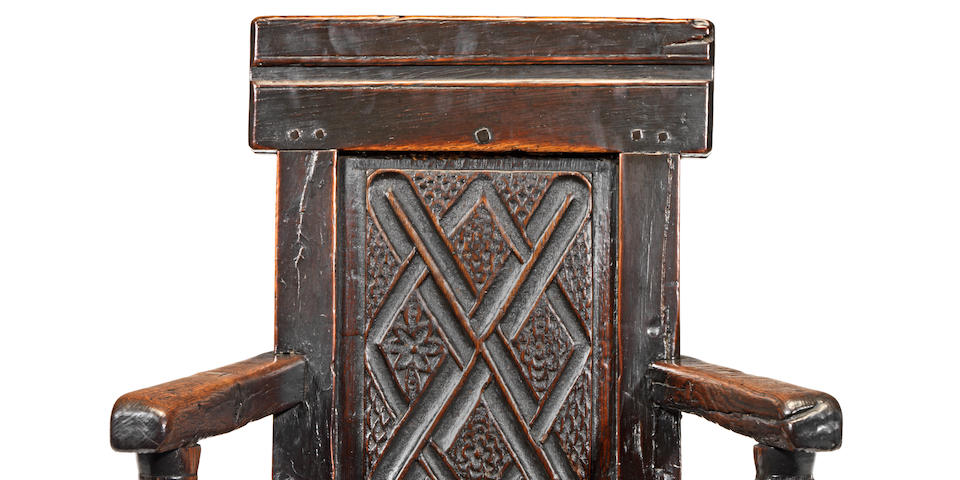 A Charles II joined oak panel-back open armchair, Scottish, circa 1680