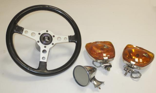A Nardi leather-rimmed steering wheel to suit Fiat Abarth,   ((4))