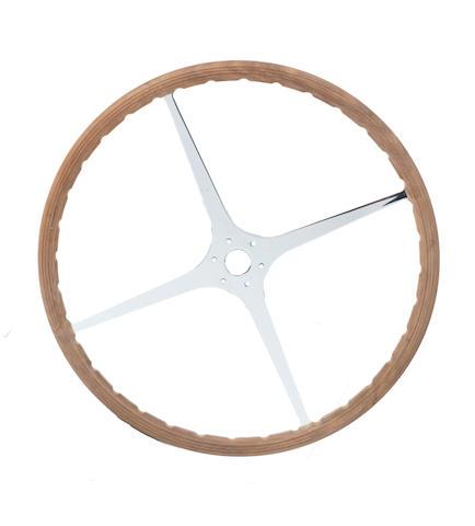 A four spoke wooden rimmed steering wheel,