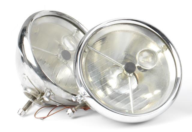 A pair of Lucas electric Bulls-eye headlamps,   ((2))