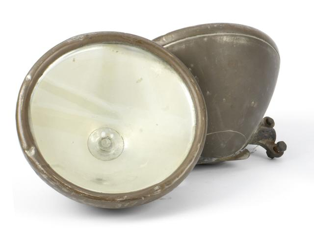 A pair of brass electric headlamps, British, 1920s,  ((2))
