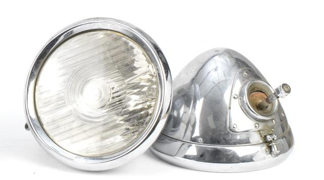 A pair of Lucas Bi-flex Long-Range electric headlamps, British,   ((2))