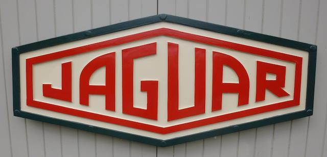 A 'Jaguar' garage display emblem,