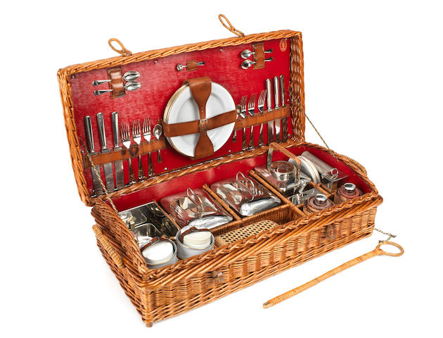 A fine wicker-cased picnic set for six persons by G W Scott & Sons, circa 1909,